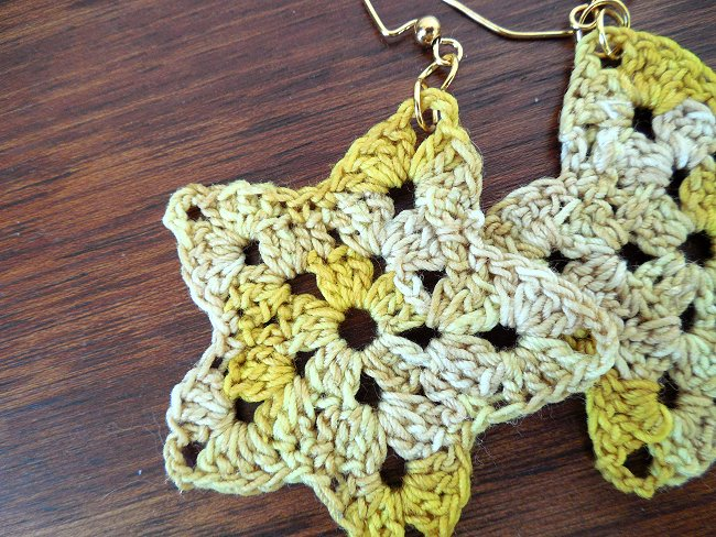 yellow variegated star earrings
