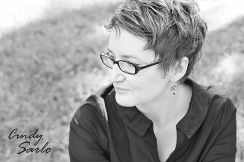 author jody wallace black and white serious writer bio photo or it would be if i wasn't smirking