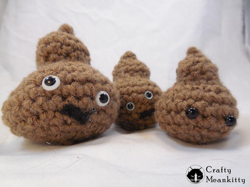 some crocheted poop emojis